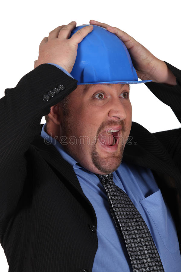 A surprised businessman. In suits stock image