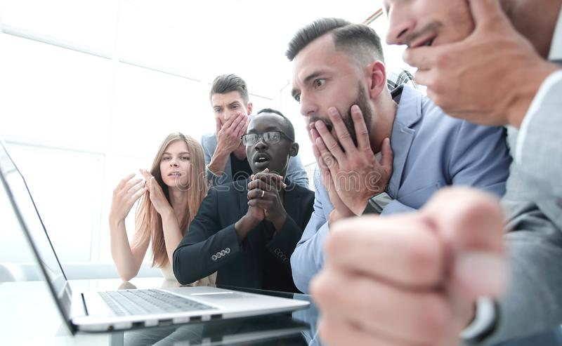 Frustrated females and males sales managers working in showroom, looking at laptop monitor stock photography