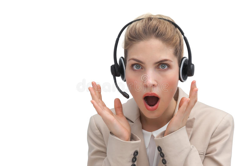 Surprised call center agent with hands raised stock photo