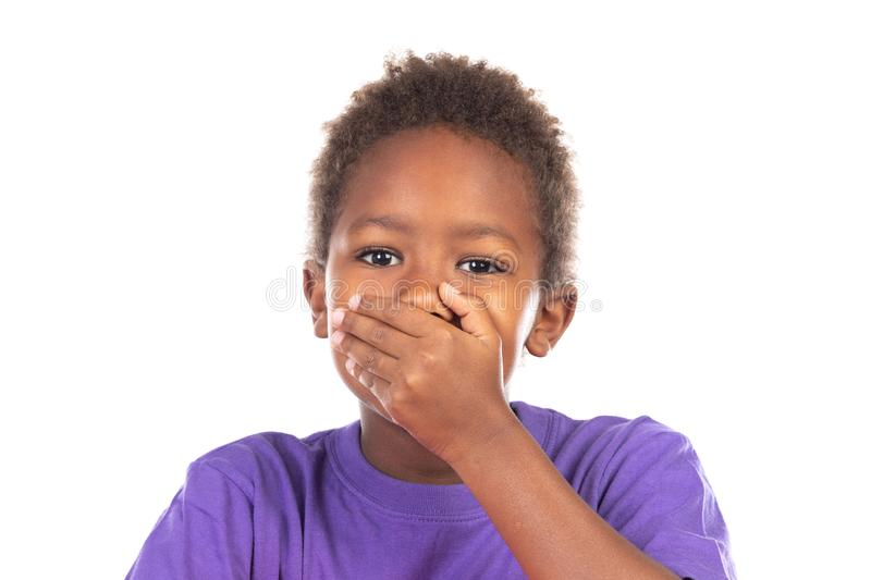 Surprised child covering his mouth stock photography