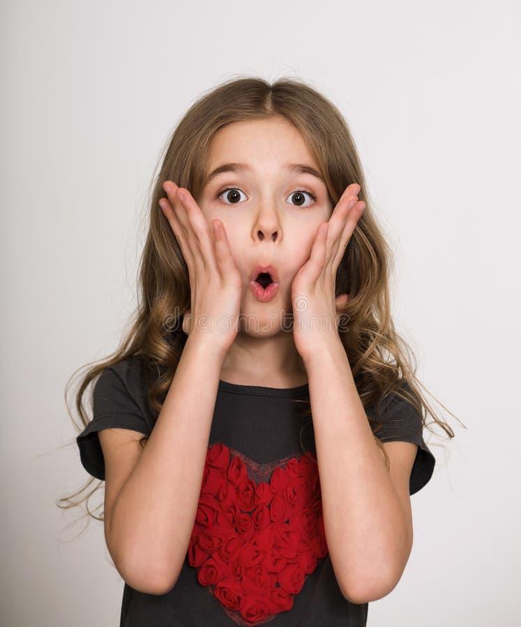 Surprised child girl stock photos