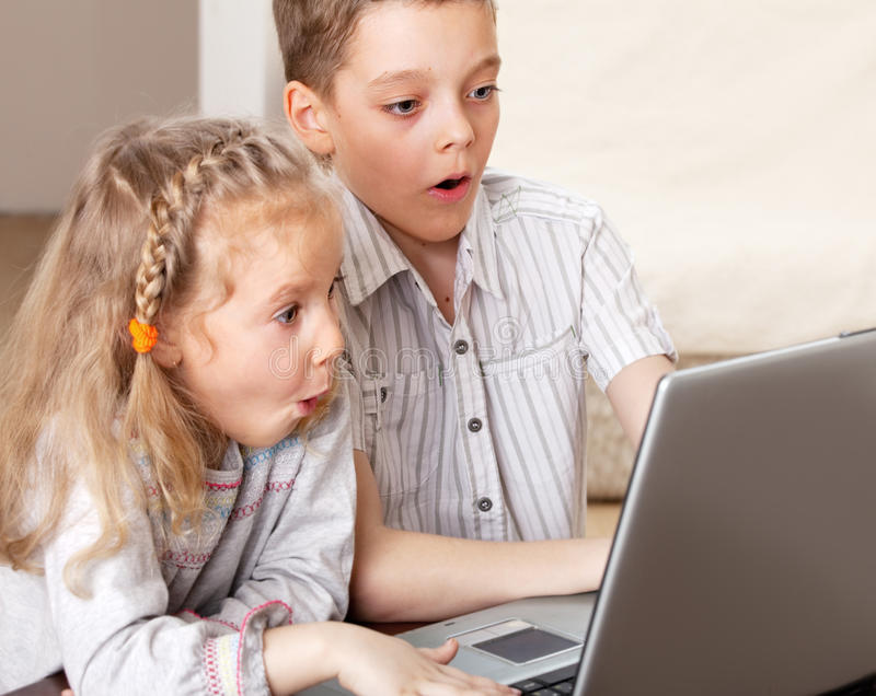 Surprised child looking at laptop royalty free stock images
