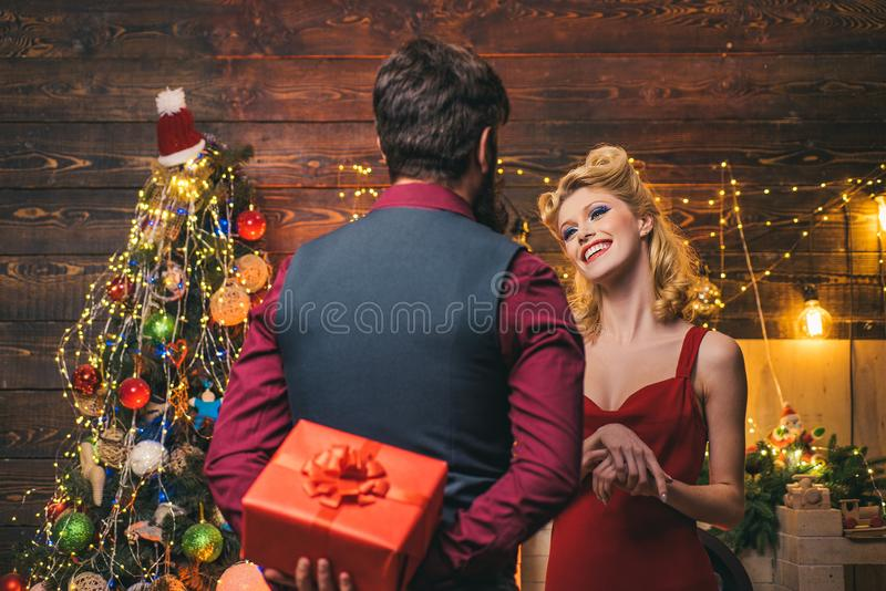 Surprised Christmas couple. Family couple celebrating new year or an event. Very beautiful couple over Christmas tree stock images