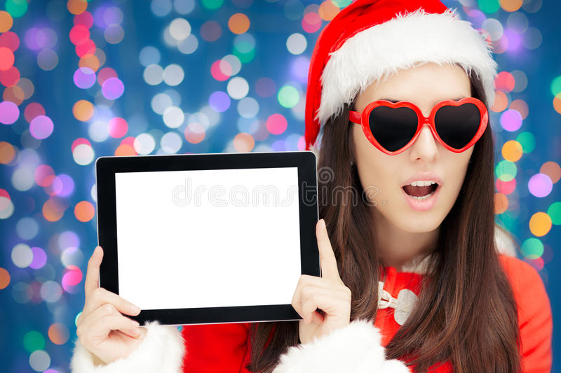 Surprised Christmas Girl with Heart Sunglasses and Tablet royalty free stock photo