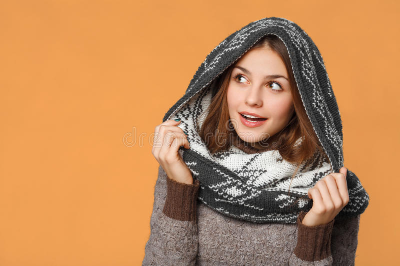 Surprised christmas girl wearing knitted wear scarf. Excited beautiful smiling girl, winter concept, isolated royalty free stock images