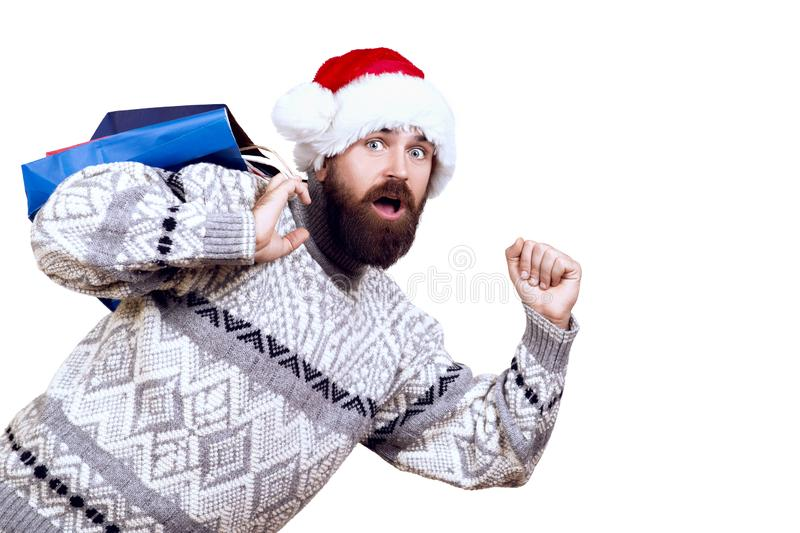 Surprised Christmas man go to shopping. Christmas sales and discount concept. Man holding shopping bags. Copy space. Christmas royalty free stock image