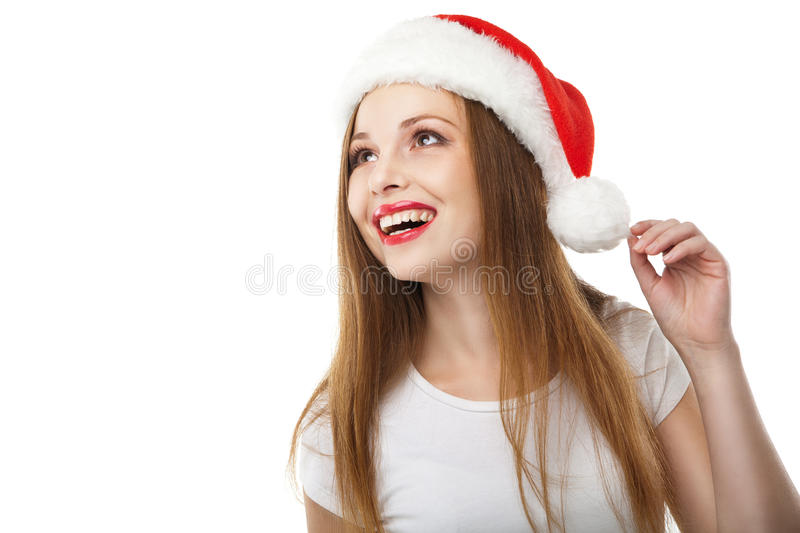 Surprised christmas woman wearing santa hat. Smiling isolated over white background stock photo