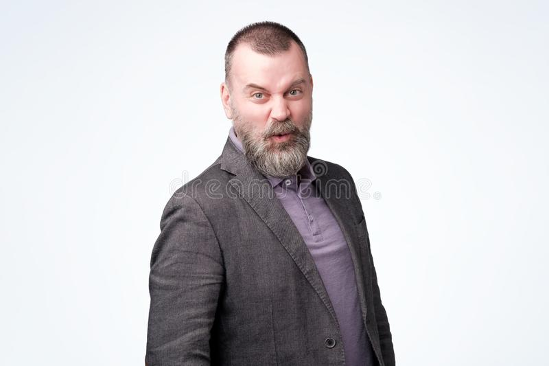 Surprised or confused middle age man in jacket. royalty free stock photos