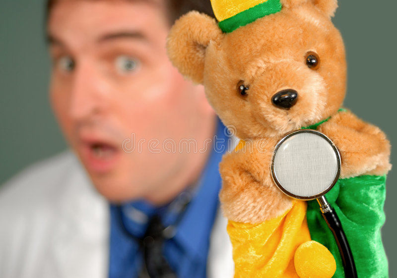 Surprised Doctor with Puppet, shallow DOF royalty free stock image
