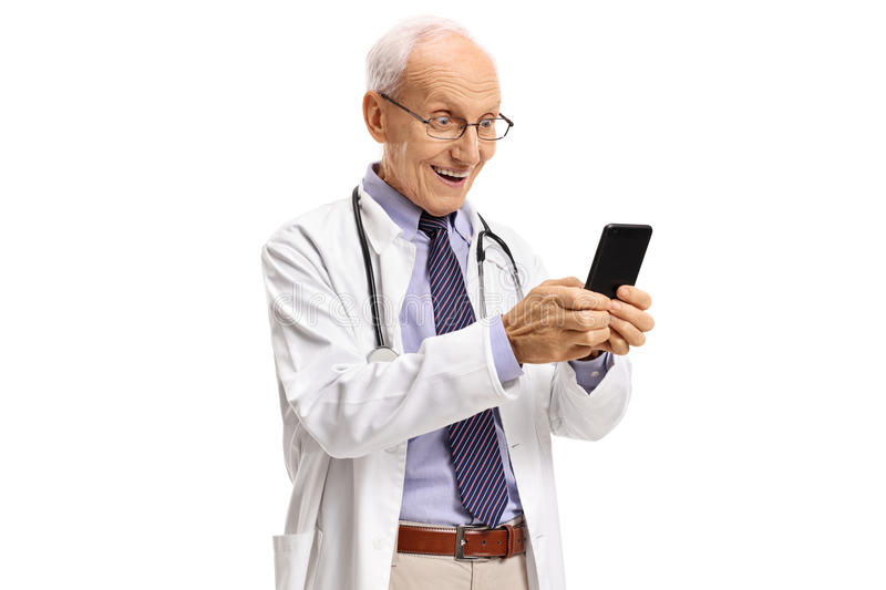 Surprised elderly doctor using a phone. Isolated on white background royalty free stock images