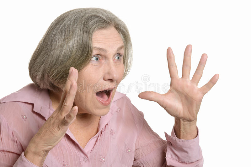 Surprised elderly woman. Isolated on a white background stock photography