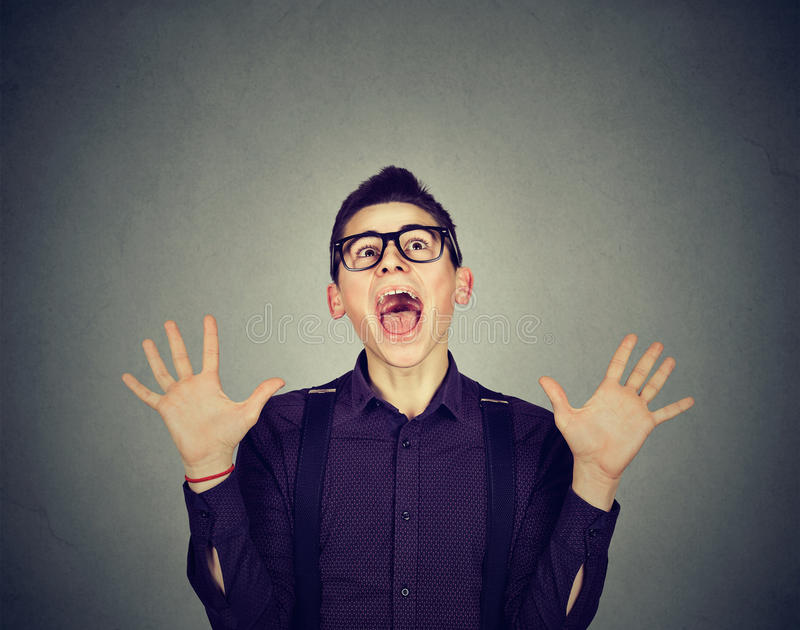 Surprised excited funky looking man screaming stock photography