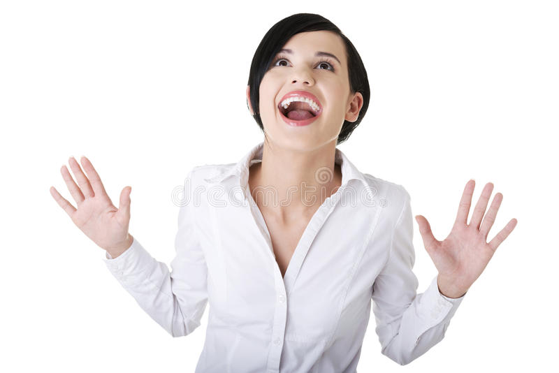 Surprised excited young business woman looking up stock photo