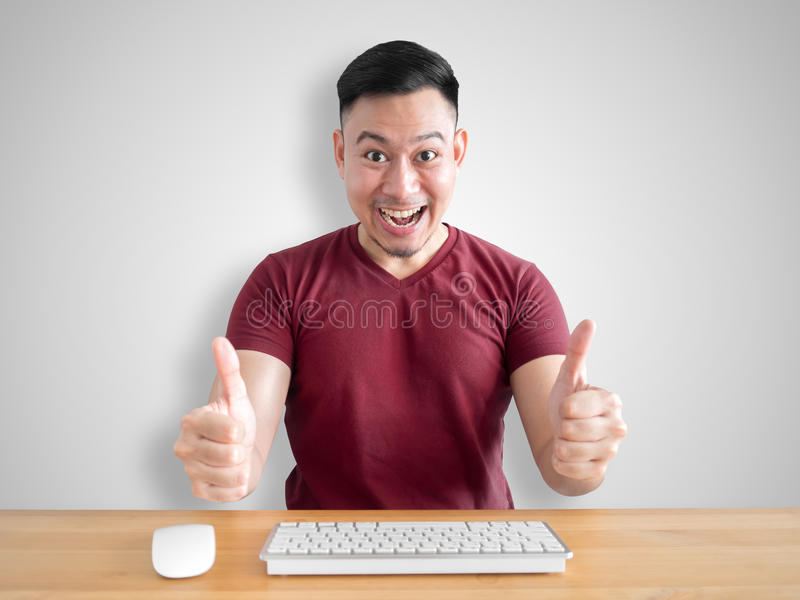 Surprised face of cheerful man in his office. stock photo