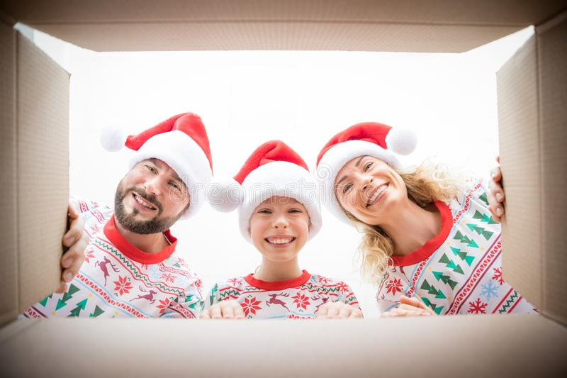 Surprised family unpack Christmas gift box stock photo