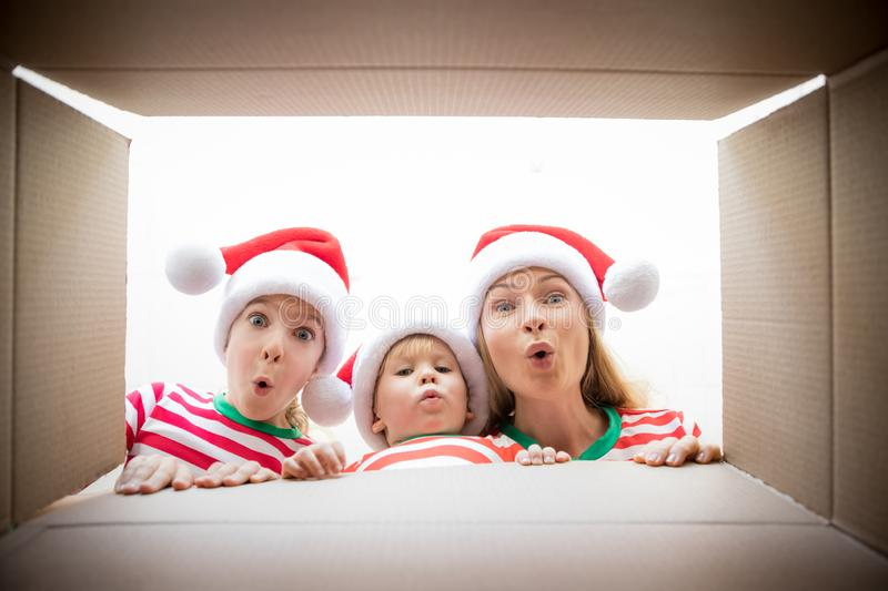 Surprised family unpack Christmas gift box royalty free stock photos