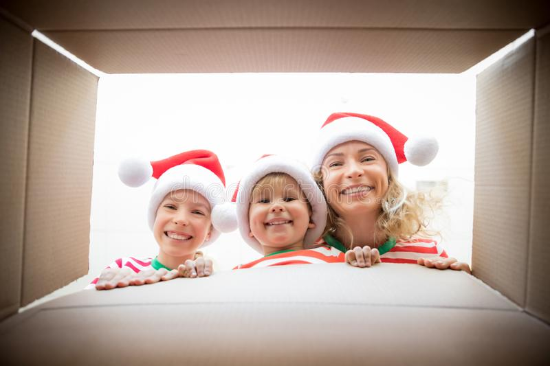 Surprised family unpack Christmas gift box stock images