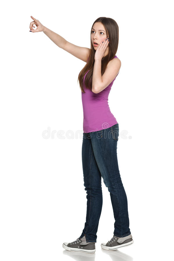 Download Surprised Female In Full Length Pointing To The Side Stock Image - Image: 33641335