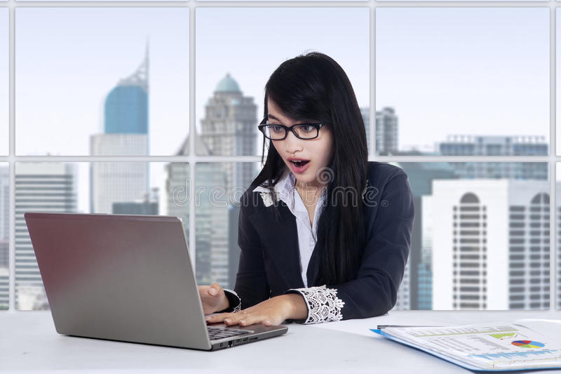 Surprised female worker in the office stock photos