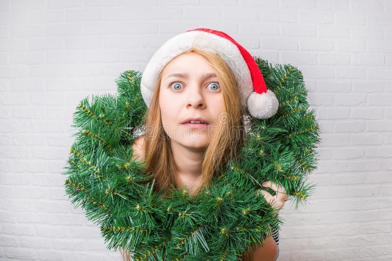Surprised and funny christmas girl with christmas decoration. Wi royalty free stock photo