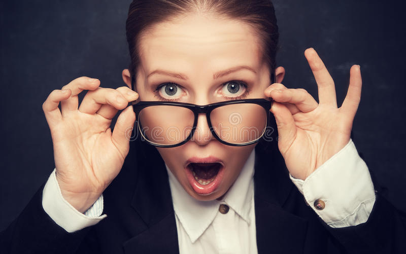 Surprised funny teacher in glasses shouts royalty free stock photos