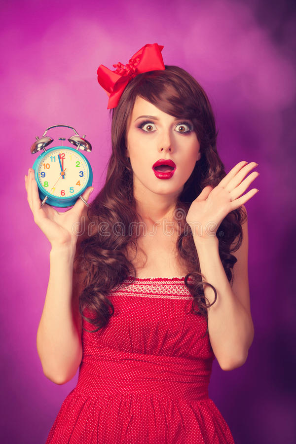 Surprised girl with alarm clock royalty free stock image