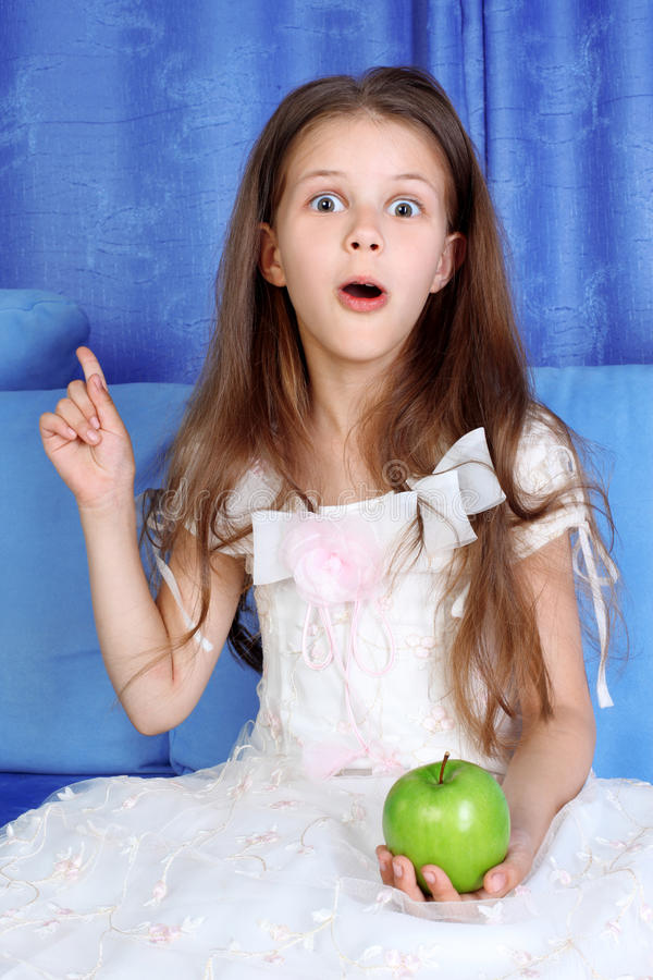Download Surprised girl with apple stock image. Image of childhood - 14857525