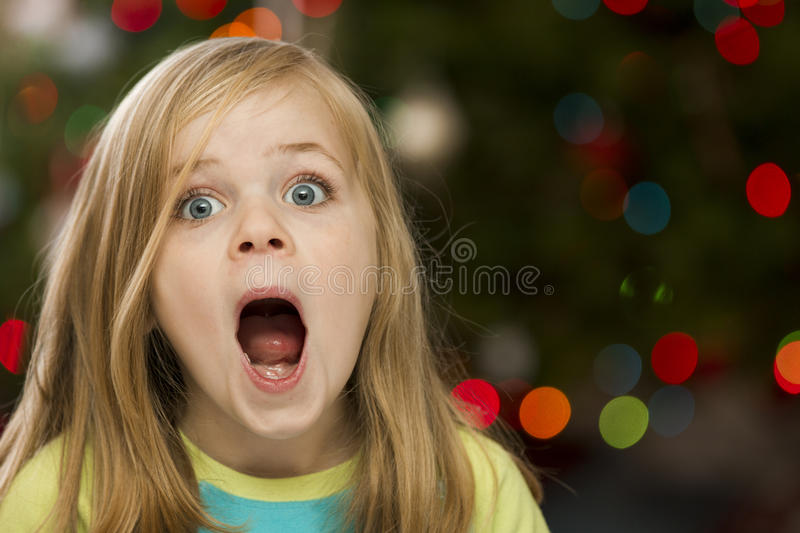 Surprised girl during christmas stock images