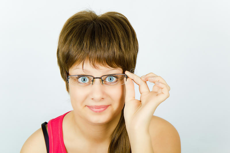 Download Surprised girl in glasses stock photo. Image of hand - 17261622