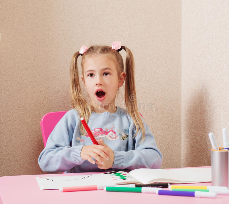 Surprised girl at home royalty free stock image