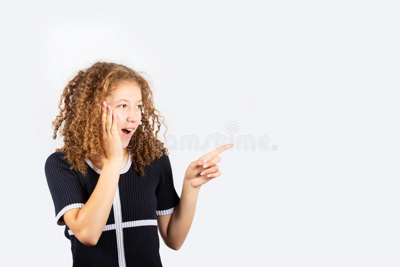 Shocked young girl pointing stock photos