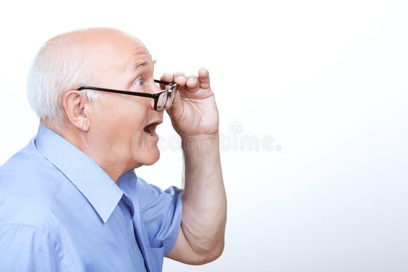 Surprised grandfather showing wonder stock photo