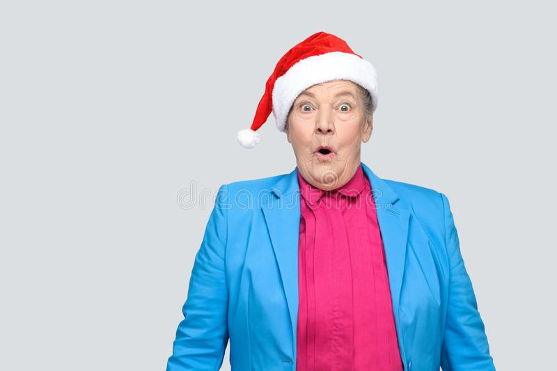 Surprised grandmother in colorful casual style with blue suit an stock image