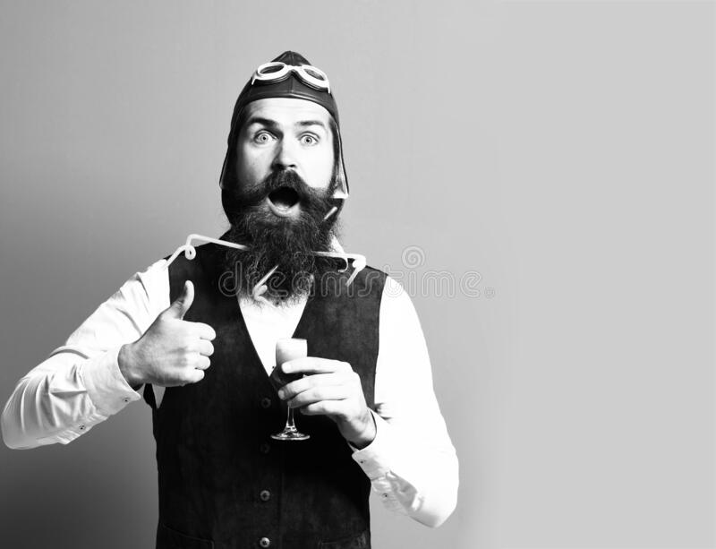 Surprised handsome bearded pilot with long beard stock photo