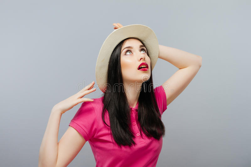 Surprised happy beautiful woman looking sideways in excitement. Isolated on grey background royalty free stock images