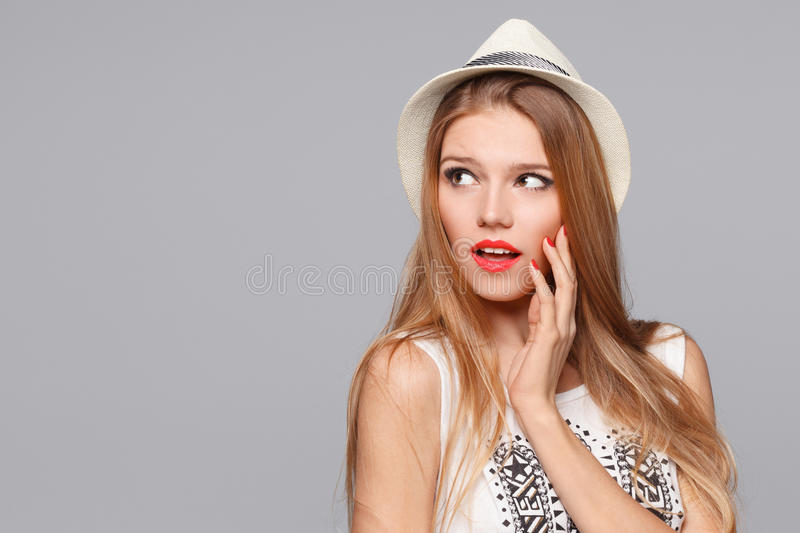 Surprised happy beautiful woman looking sideways in excitement. Isolated over gray royalty free stock images