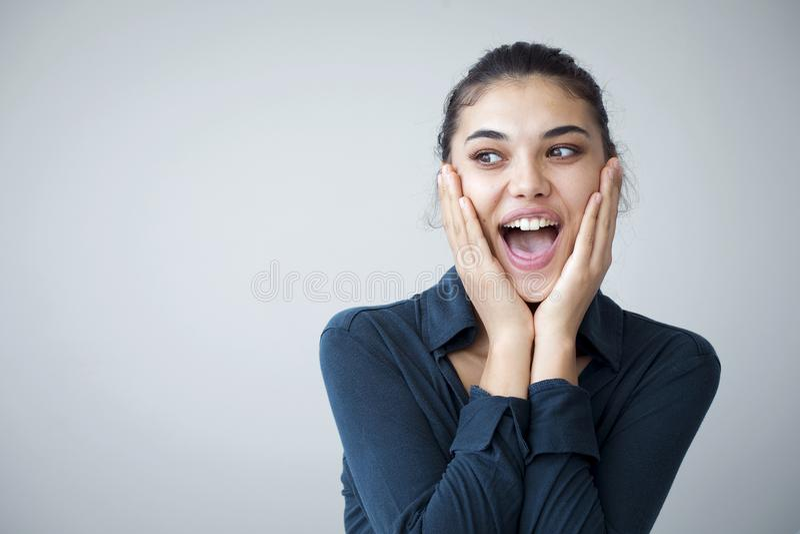 Surprised happy beautiful woman looking sideways in excitement royalty free stock photo