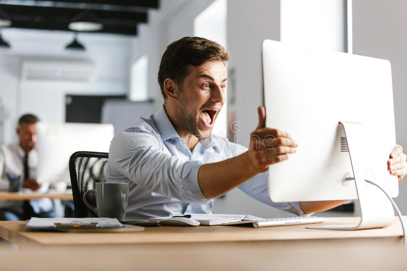 Surprised happy male manager screaming and rejoices royalty free stock photography