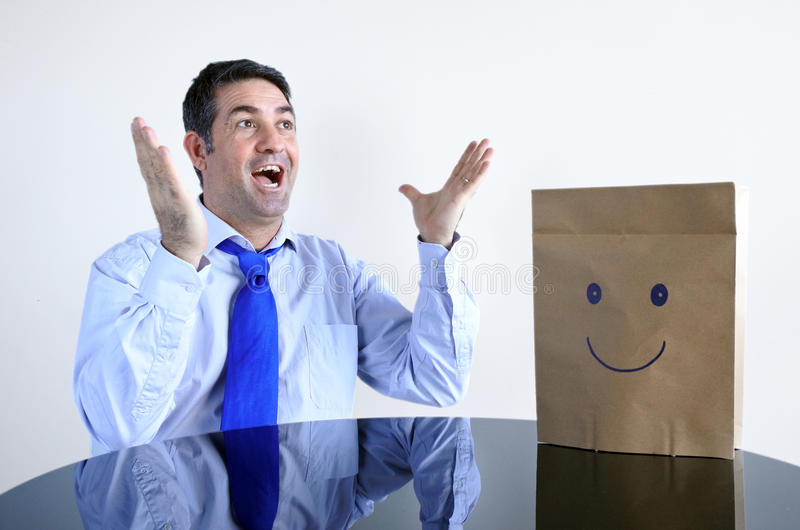 Surprised happy man sit at the table alon royalty free stock photos
