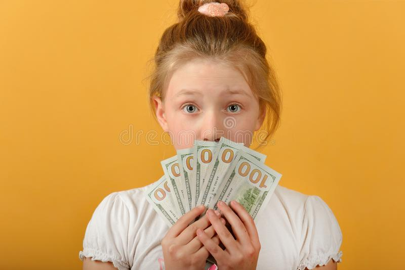 Surprised and joyful girl covers her face with money royalty free stock photos
