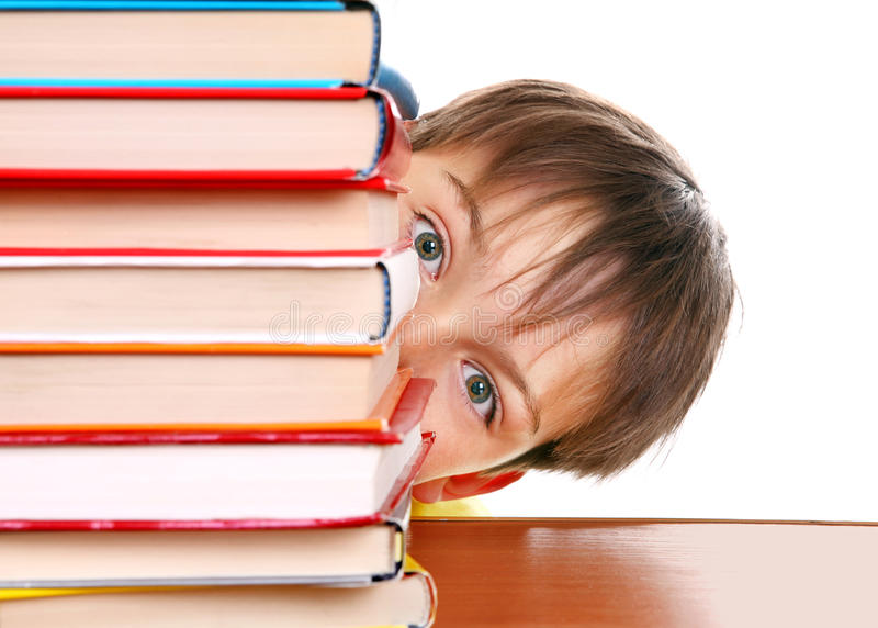 Surprised Kid behind the Books. Isolated on the White Background stock photography