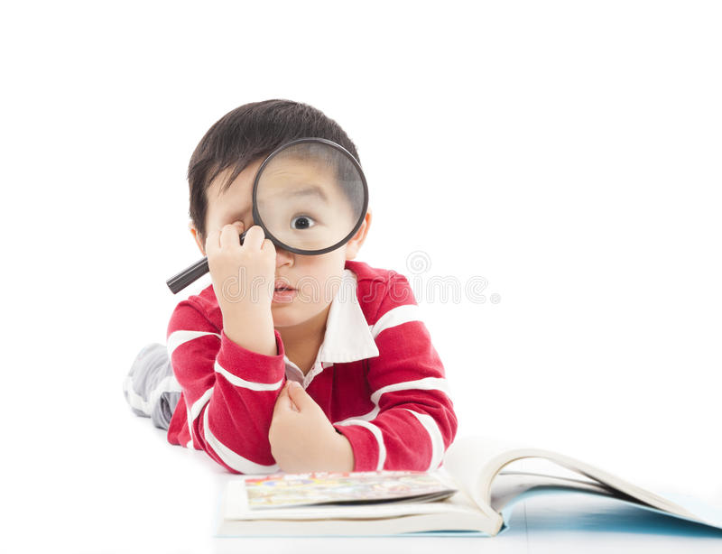 Surprised kid is holding magnifying glass stock images