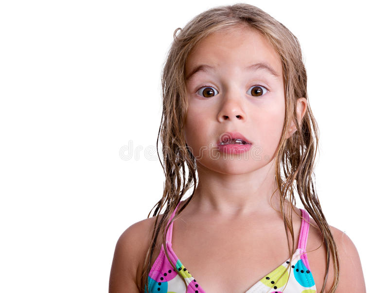 Surprised little blond girl with wet hair stock photos