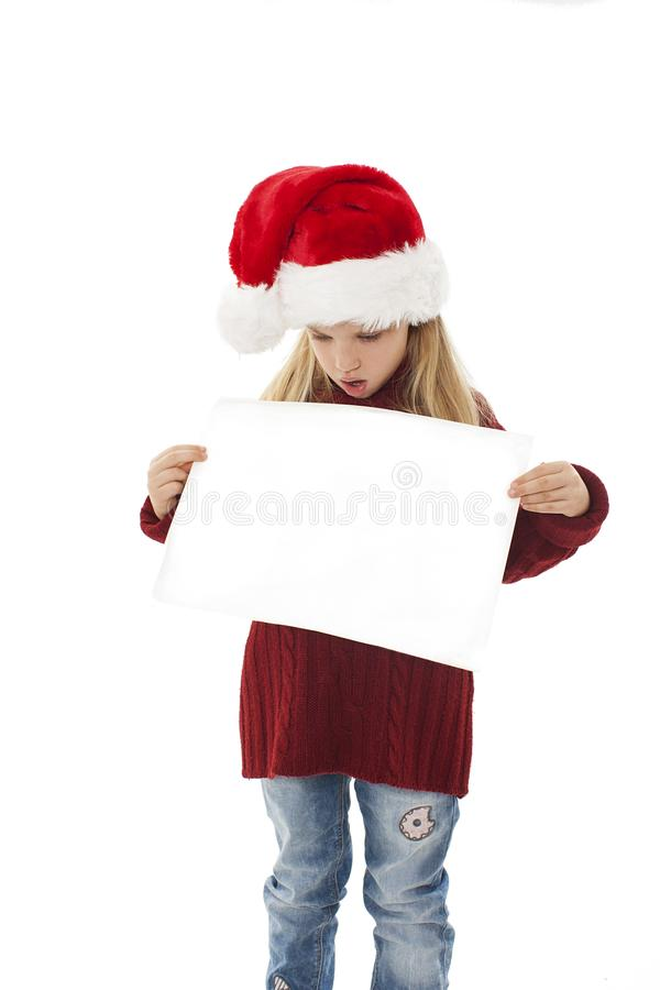 Surprised little christmas girl presenting. Isolated on white background stock images