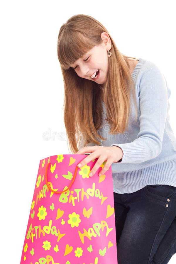 Surprised Little Girl With Gift Stock Photo