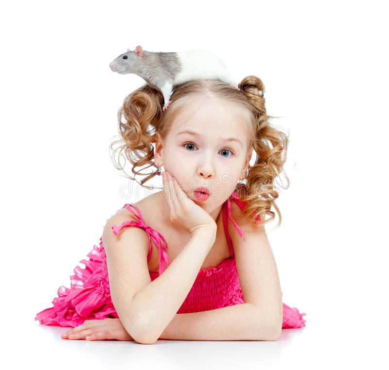Surprised little girl with pet rat on her head royalty free stock images