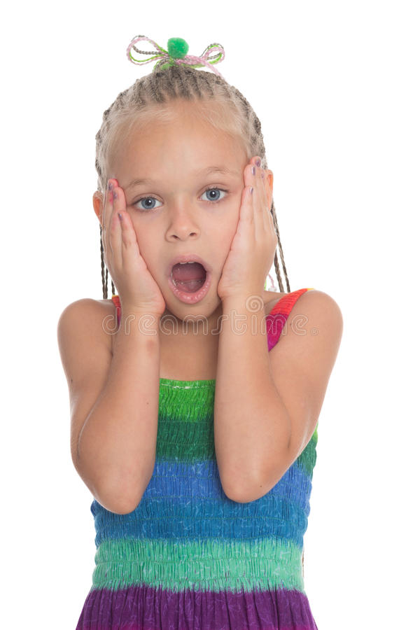 Surprised little girl of six years stock photos