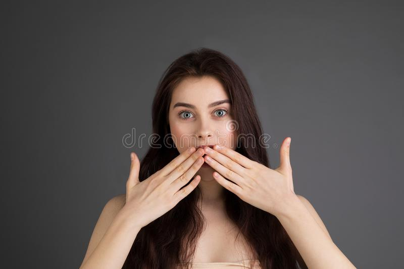 Surprised long haired brunette woman with blue eyes stock images
