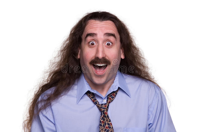 Surprised long haired Man1. A long haired man with a surprised & happy expression royalty free stock photos