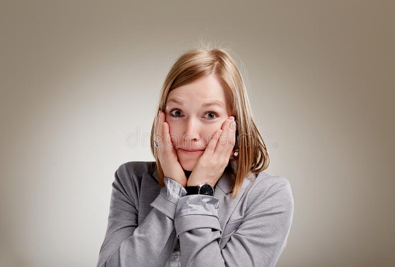 Surprised looking blonde girl stock photography